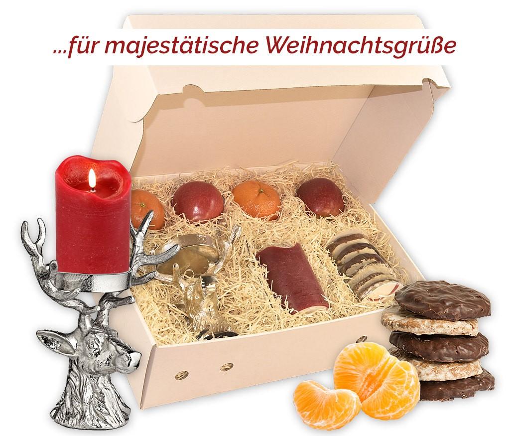 Weihnachtsbox mit frischen Clementinen und Äpfeln, leckeren Lebkuchen und einem schönen Hirschkopf-Kerzenhalter mit einer LED Kerze