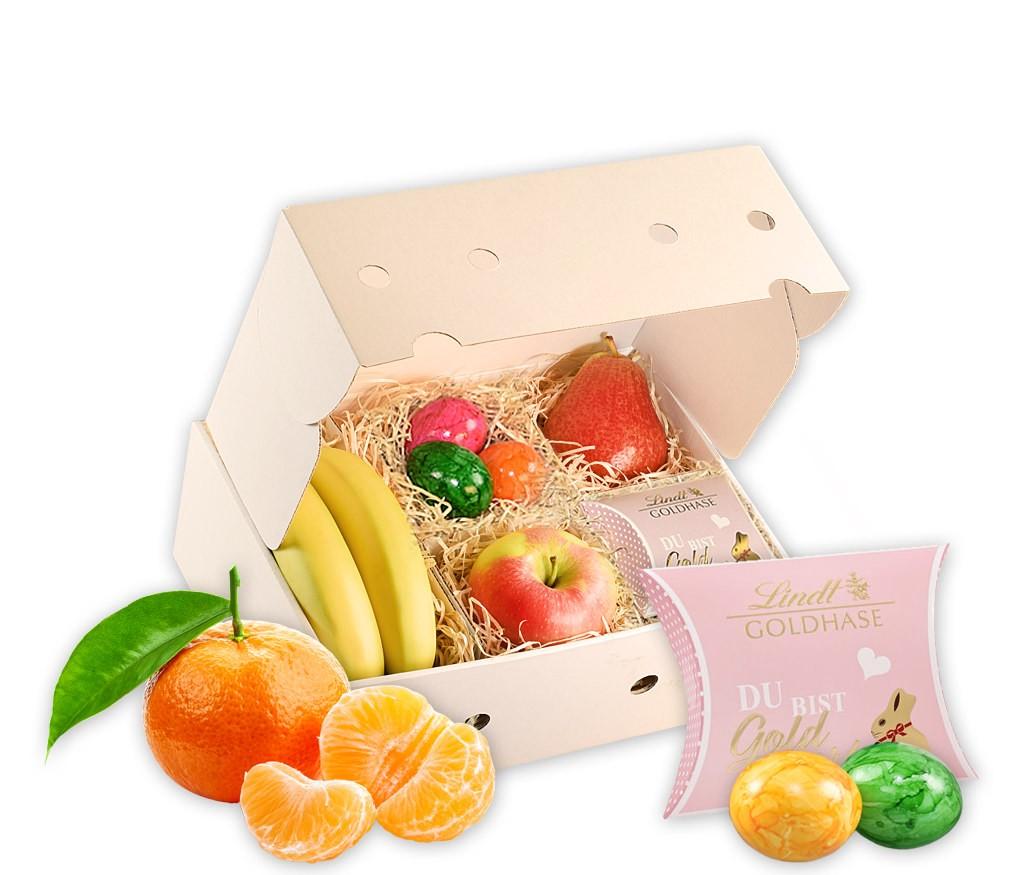 Obstbox Kleine Osternascherei mit frischem Obst, bunten Ostereiern, zartschmelzenden belgischen Pralinen