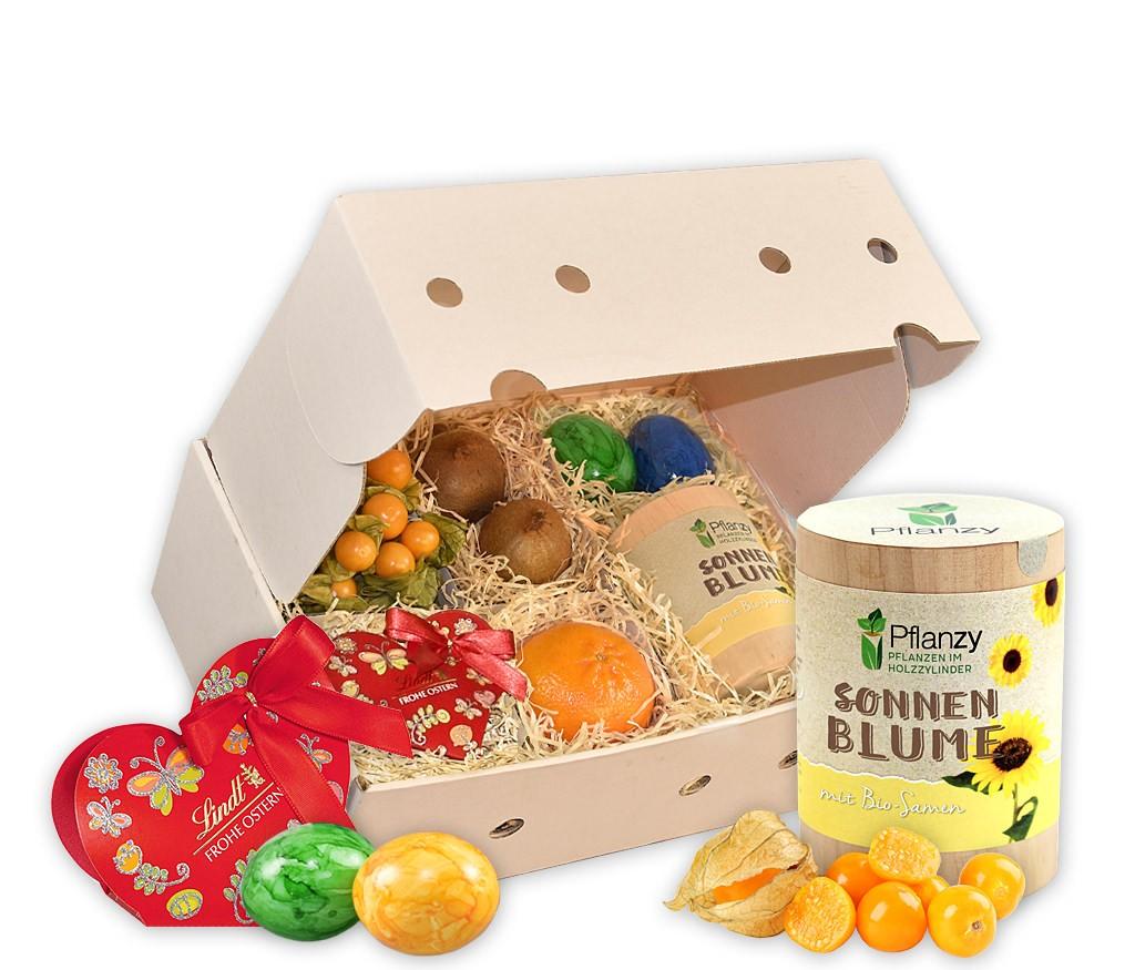 Obstbox Kleines Osternest mit Lindor-Kugeln, Schoko-Henne, bunten Ostereiern und frischem Obst