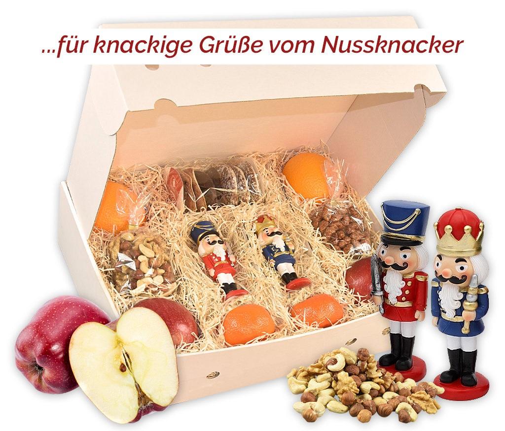 Obstbox Nussknacker mit frischem Obst, gesunden Nüssen, gebrannten Mandeln, Lebkuchen und zwei Nussknackerfiguren