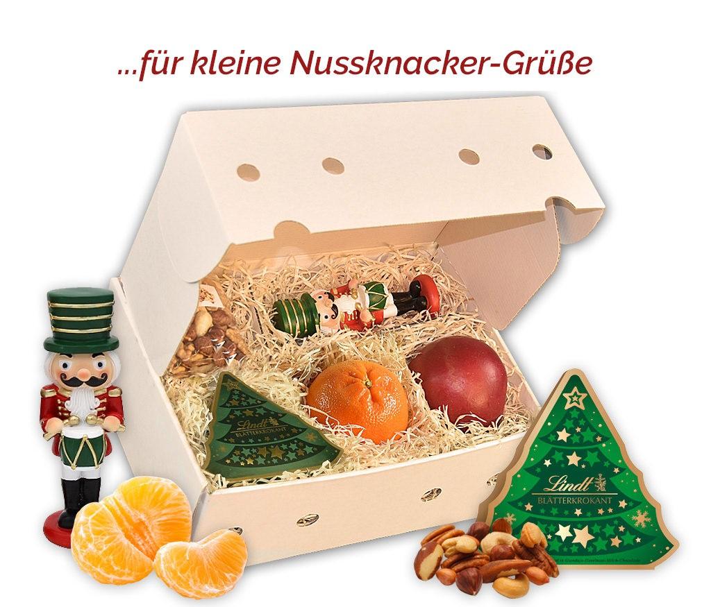 Obstbox Kleiner Nussknacker mit gebrannten Mandeln, dekorativem Holznussknacker und frischem Obst