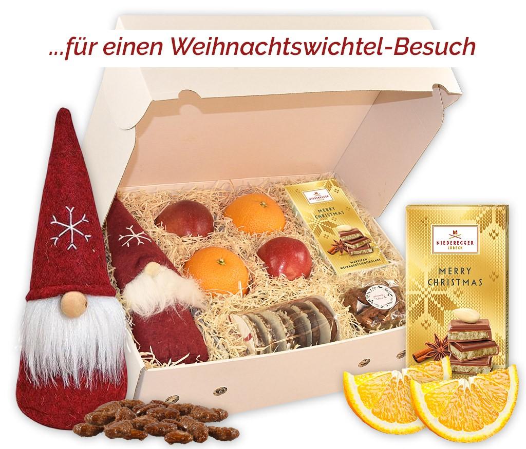 Obstbox Weihnachtswichtel mit frischem Obst, Lebkuchen, Haselnüssen, gebrannten Mandeln und knuffigem Filzwichtel
