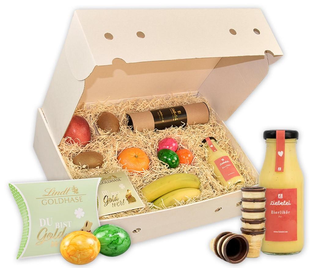 Obstbox Osterlikörchen mit handgemachten Eierlikör, Waffelbechern, bunten Eiern, Lindt Schokoladen-Kücken und frischem Obst