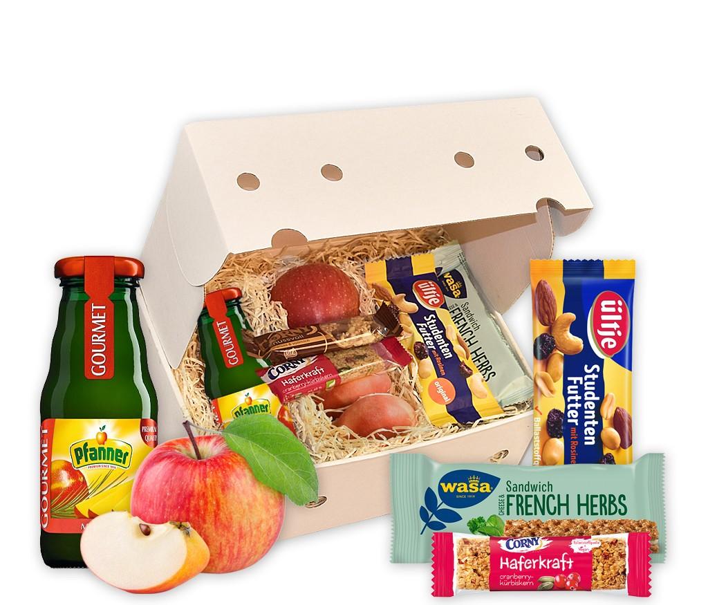 Homeoffice-Snack-Box mit Saft, Studentenfutter, Wasa Sandwich, Corny Riegeln und frischem Obst