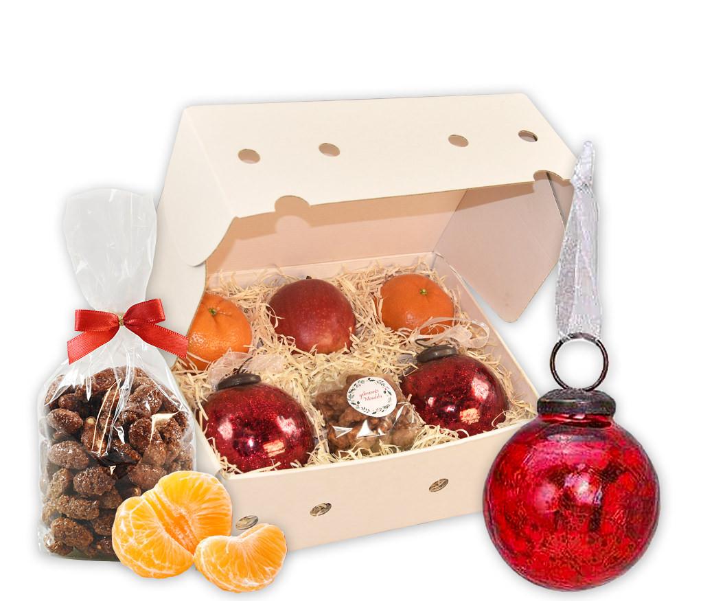Obstbox Weihnachtskugeln mit frischem Obst, gebrannten Mandeln und roten Weihnachtskugeln aus Craque-Glas