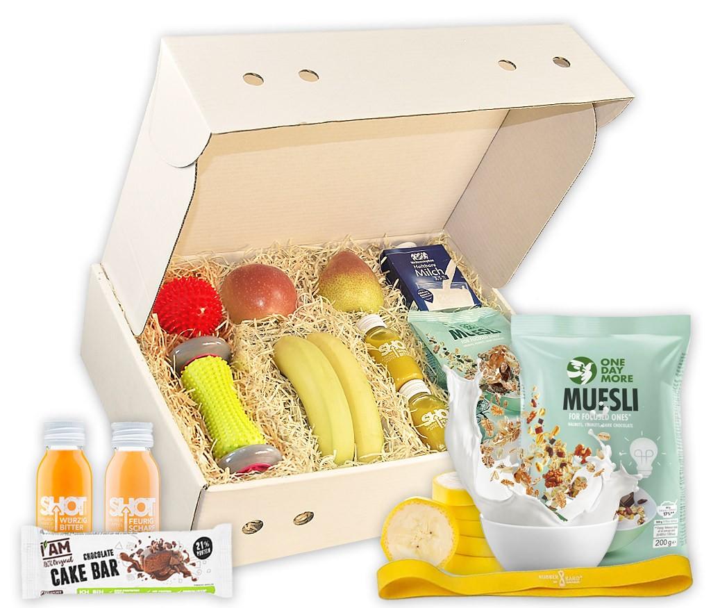 Obstbox Fitness mit frischem Obst, Müsli, Proteinriegel, saftigen Shots, Loop-Band und Massagebällen in einer Geschenkbox